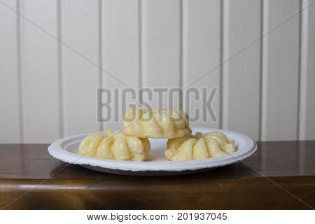 Close up of three sweet donuts on a plate