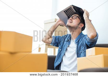 Young Asian Man Unsuccess for Work about Online Business or SME Young Owner Man in Stress Situation Man with Online Business or SME Concept.