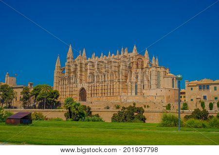 PALMA DE MALLORCA, SPAIN - AUGUST 18 2017: Outdoor view of Cathedral of Santa Maria of Palma La Seu in a gorgeous blue sky, in Palma de Mallorca, Spain.