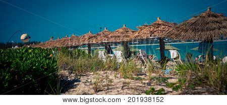 Row of tiki huts on grace beach
