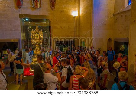PALMA DE MALLORCA, SPAIN - AUGUST 18 2017: Unidentified people enjoying the interior view of Cathedral of Santa Maria of Palma La Seu in Palma de Mallorca, Spain.