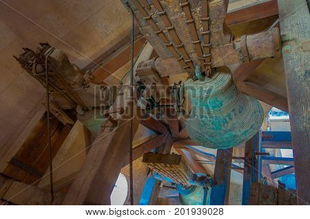 PALMA DE MALLORCA, SPAIN - AUGUST 18 2017: Indoor view of the Cathedral of Saint Eulalia church with a green bell inside of the building, located in Palma de Mallorca, Spain.