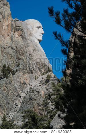 Mount Rushmore face of George Washington profile of president faces in Black Hills of South Dakota