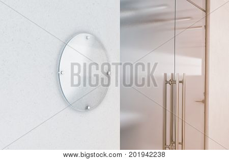 Blank round transparent glass sign plate mockup 3d rendering. Circular nameplate mock up on the wall near office entrance interior. Signage panel store door template. Printing board for branding.