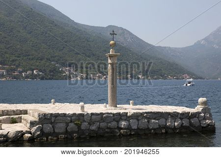 PERAST, MONTENEGRO - AUGUST 04, 2017:Memorial sign on the site where the icon of Our Lady was found on Our Lady of the Rocks Montenegro.