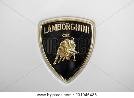 CRACOW POLAND - MAY 20 2017: Lamborgini metallic logo closeup on Lamborghini car displayed at 3rd edition of MOTO SHOW in Cracow Poland. Exhibitors present most interesting aspects of the automotive industry
