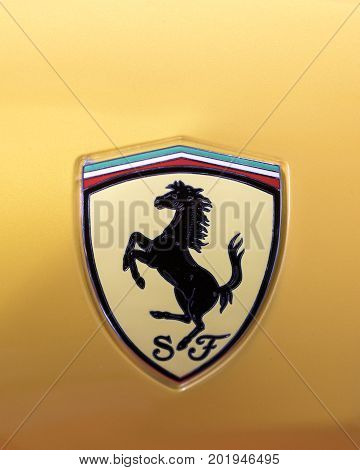 CRACOW POLAND - MAY 20 2017: Ferrari metallic logo closeup on Ferrari car displayed at 3rd edition of MOTO SHOW in Cracow Poland. Exhibitors present most interesting aspects of the automotive industry
