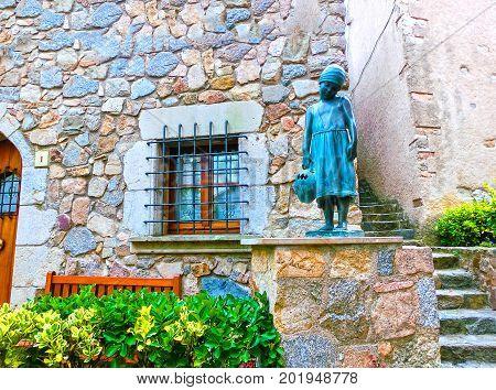 Tossa de Mar, Spain - September 14, 2015: Bronze statue of little girl in the Spanish town of Tossa de Mar, Spain on September 14, 2015