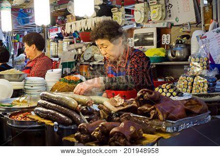 Seoul, South Korea - April 08, 2017: Woman Vendor Preparing A Food At Gwangjang Market In Seoul. It'