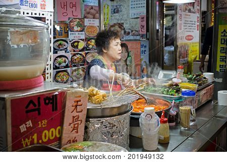 Seoul, South Korea - April 08, 2017: Woman Vendor Preparing A Food At Gwangjang Market In Seoul. It'