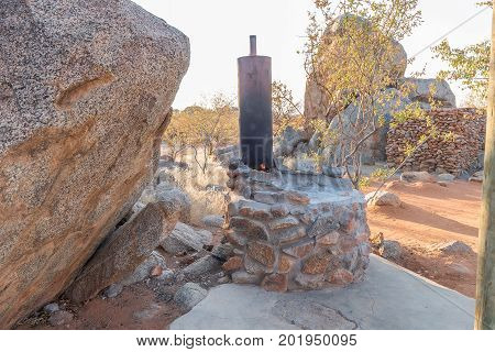 HOADA NAMIBIA - JUNE 27 2017: A wood-fired donkey provides hot water for the showers in the back at the Hoada Rest Camp in the Kunene Region of Namibia