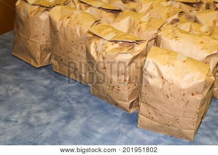 Brown Bags Filled With Popcorn Ready For Students
