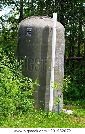 An Fiberglass Outhouse In A Rustic Campground