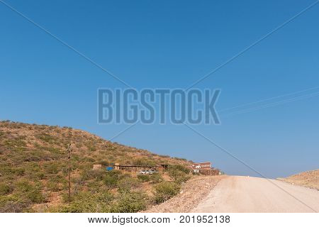 GROOTBERG PASS NAMIBIA - JUNE 28 2017: Turn-off to a lodge at the top of the Grootberg Pass on the C40-road between Kamanjab and Palmwag in the Kunene Region of Namibia