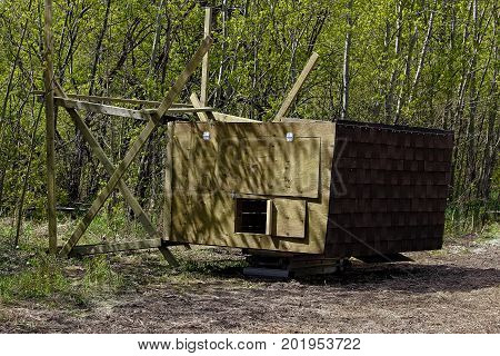 A Hunting Blind On It's Side So The Legs Can Be Put On