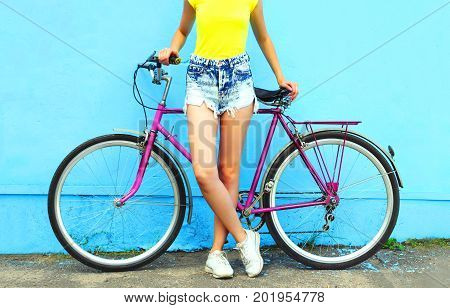 Summer Fashion Woman And Bicycle On A Colorful Blue Background