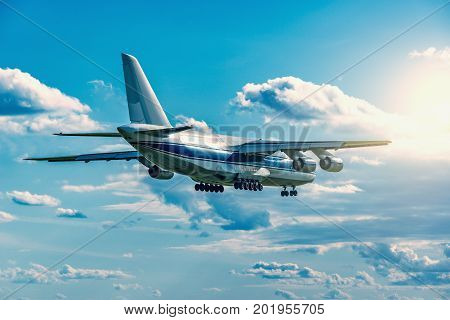 Flight of the big cargo airliner at sunny day time.