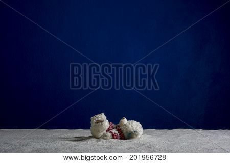 Children's toy bear cub on a blue background, Christmas composition