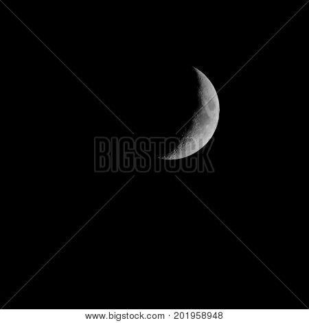 Cresent moon in dark night sky lunar