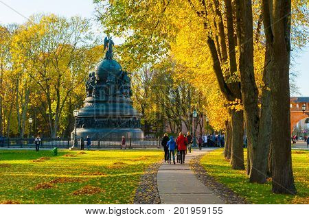 VELIKY NOVGOROD RUSSIA - OCTOBER 9 2016. The monument Millennium of Russia in autumn evening and people walking in the autumn park in Veliky Novgorod Russia