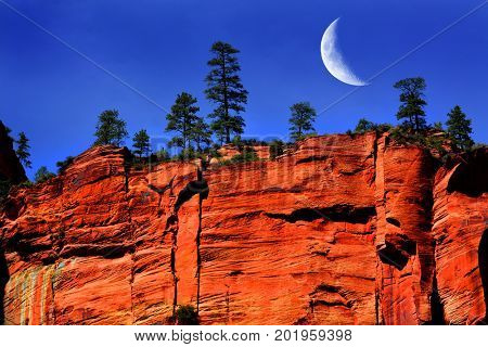 Red rock cliffs in Zions National Park Utah explore wilderness rugged mountains with crescent moon
