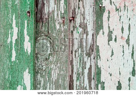 Texture wooden background of old wooden painted texture surface with green peeling paint texture. Texture of green peeling paint on the wooden texture background. Wooden surface with texture green peeling paint