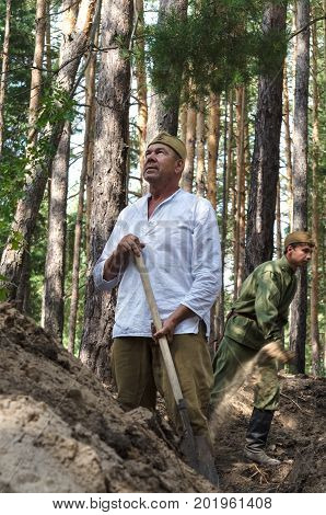 Reconstruction of the events of World war II, Russia, Dimitrovgrad, 26 Aug 2017. Portrait of the red army, digging trenches.