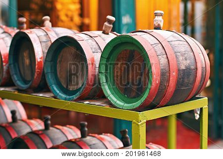 Old wooden wine barrels on the market