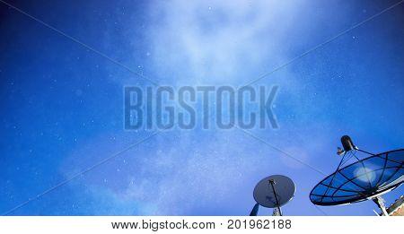 Satellite dish under starry night sky in summer