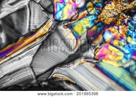 microscopic shot showing Ammonium sulfate crystals illuminated with polarized light
