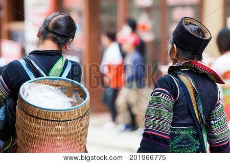 SA PA, VIETNAM - AUGUST 2017: Black hmog ethnic minority women in Sa Pa town, the high mountains, Lao Cai province, Vietnam