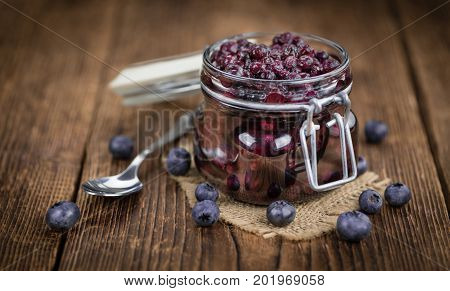 Blueberries (preserved) On Wooden Background; Selective Focus