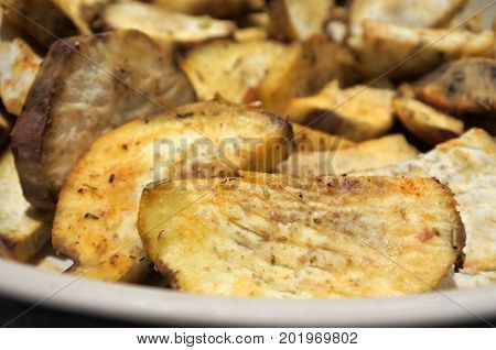 Kumara sweet potato wedges. Food background and texture.