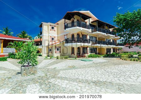 Cayo Coco island, Cuba, Colonial hotel, July 16, 2017, stunning gorgeous amazing view of Colonial hotel grounds, beautiful inviting retro stylish buildings in tropical garden square, blue sky