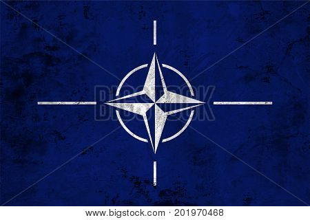 Flag of the North Atlantic Treaty Organization (NATO) against the background of the stone texture