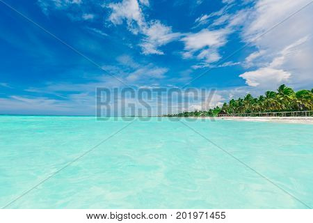 stunning gorgeous amazing view of deep blue sky and tranquil turquoise ocean merging together on horizon line with tropical beach on the side at cayo coco island, Cuba