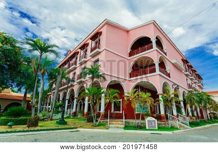 Cayo Coco island, Cuba, Colonial hotel, July 16, 2017, stunning gorgeous view of Colonial hotel grounds, beautiful inviting retro stylish main building on blue sky background