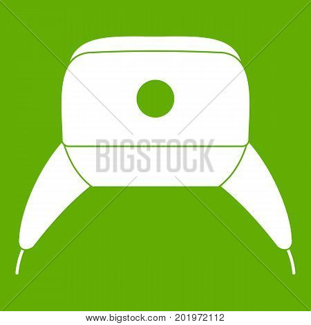 Earflap hat icon white isolated on green background. Vector illustration