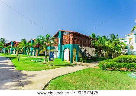 Cayo Coco island, Cuba, Iberostar Mojito resort, July 17, 2017, nice amazing view of hotel grounds with villa houses standing in tropical garden on sunny beautiful day