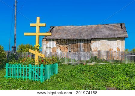 Village Legostaeva Iskitim district Novosibirsk oblast Siberia Russia - August 27 2017: the remains of the building of Michael the Archangel Church (built in 1804) and placed a wooden cross