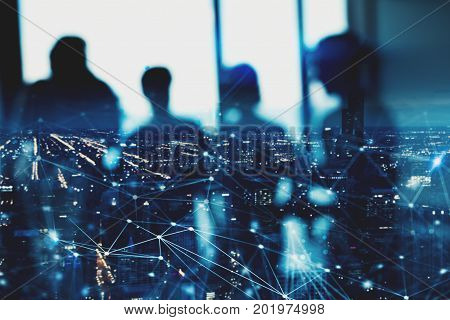 Blurred silhouette of businessperson in a modern office with network effect. concept of partnership and teamwork