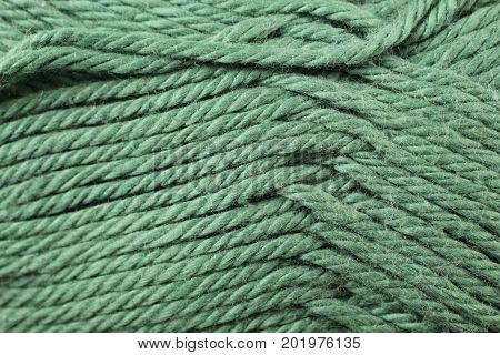 A super close up image of emerald yarn