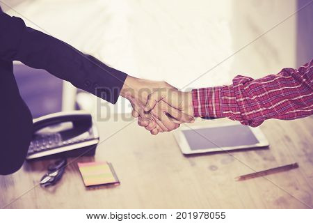 Engineers shaking hands for successBusinessmen shaking hands during a meeting.