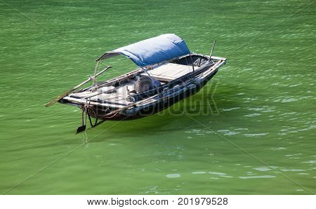traditonal vietnamese boats and floating village near Cat Ba island, Lan Ha bay, the southestern part of Ha Lng Bay, Vietnam