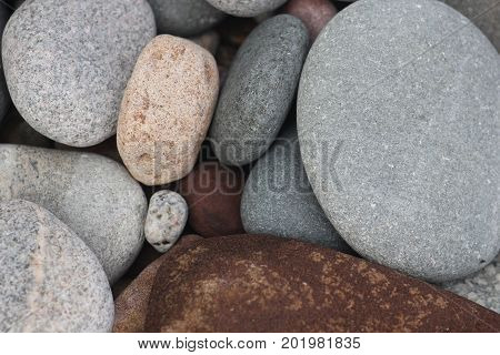 Close up of rocks and stones on a beach.  Pictured Rocks National Lakeshore, Upper Peninsula of Michigan