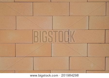 A smooth brick wall that is glued together