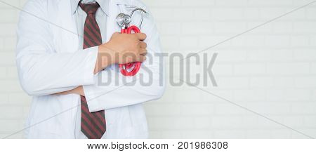 Doctor with stethoscope working in a hospital medical concept