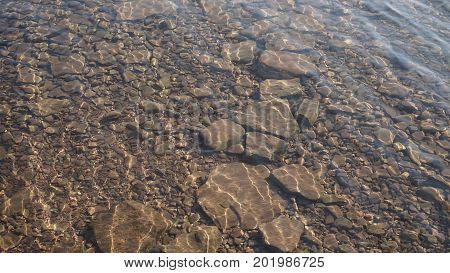 the texture of the stone bottom of the river