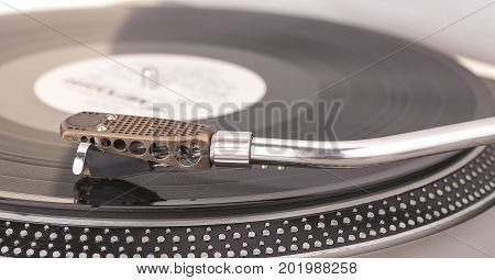 Old dusty vinyl turntable player isolated over white background