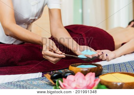 Asian lady relax in skin care aroma therapy and scrub sparelaxationhealthcare in Thailand resort